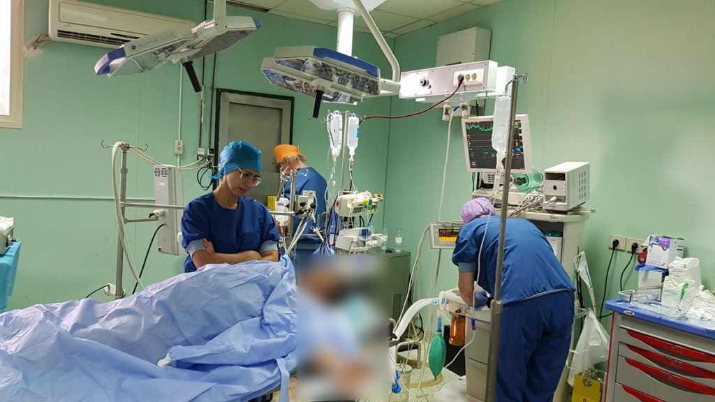 Dr. Ghada Shahin talking with the patient before the surgery